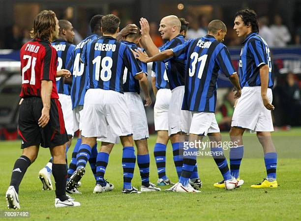 Inter Milan's Uruguyan forward Alvaro Recoba is congratulated by teammates after scoring his goal 14 August 2007 during a triangular tournament...