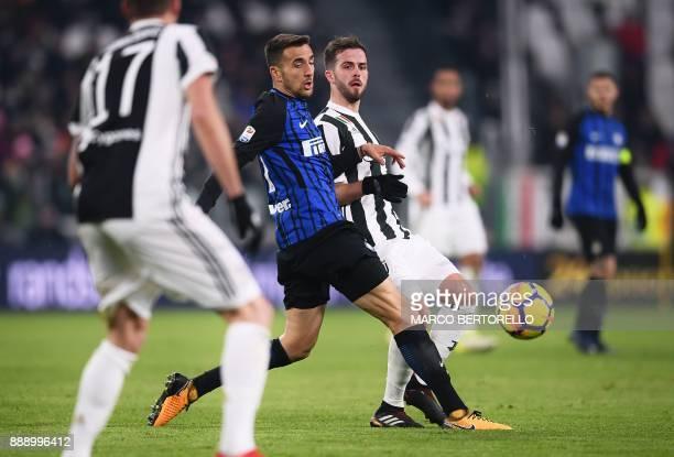 Inter Milan's Uruguyan midfielder Matias Vecino fights for the ball with Juventus midfielder Miralem Pjanic during the Italian Serie A football match...