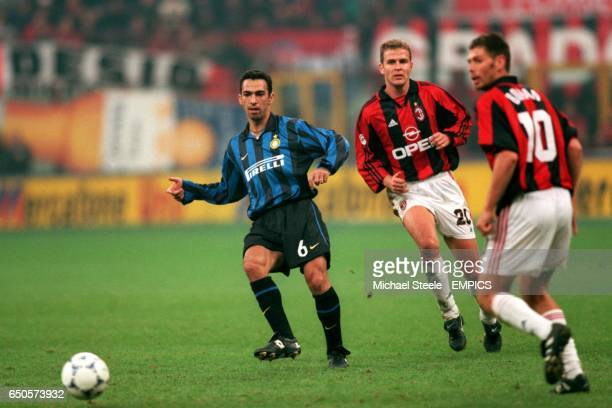 Inter Milan's Youri Djorkaeff passes the ball, watched by AC Milan's Oliver Bierhoff and Zvonimir Boban