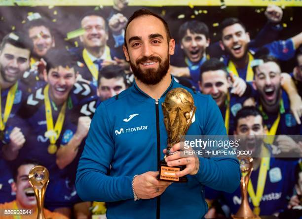 Inter Movistar's Portuguese futsal player Ricardo Filipe da Silva Braga 'Ricardinho' poses with a trophy after a training session at Jorge...