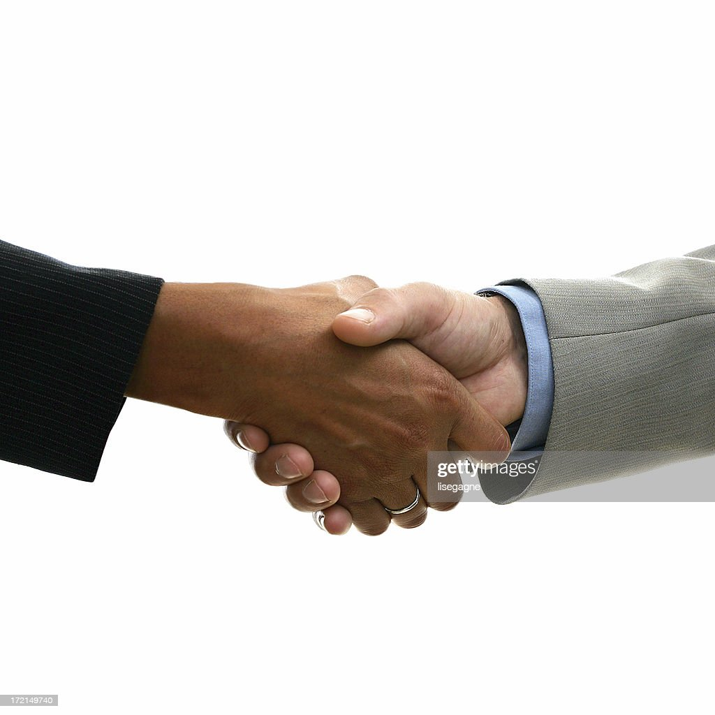 Interacial Good interacial hand shaking stock photo | getty images
