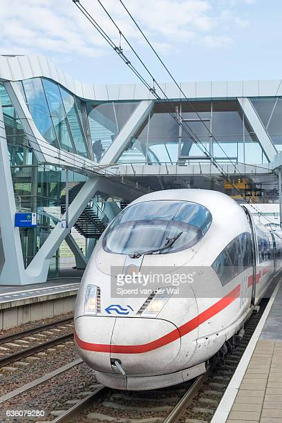 """ice -intercity express- high speed train in modern design station - """"sjoerd van der wal"""" stock pictures, royalty-free photos & images"""