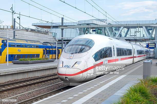 """ice -intercity express- high speed train leaving the station - """"sjoerd van der wal"""" stock pictures, royalty-free photos & images"""