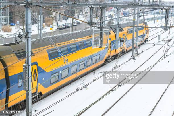 NS intercity train driving through the snow in winter