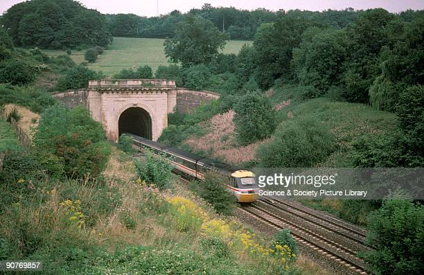InterCity Train emerging from Box Tunnel Wiltshire by Chris Hogg 1996 The tunnel designed by Isambard Kingdom Brunel is two miles long and when it...