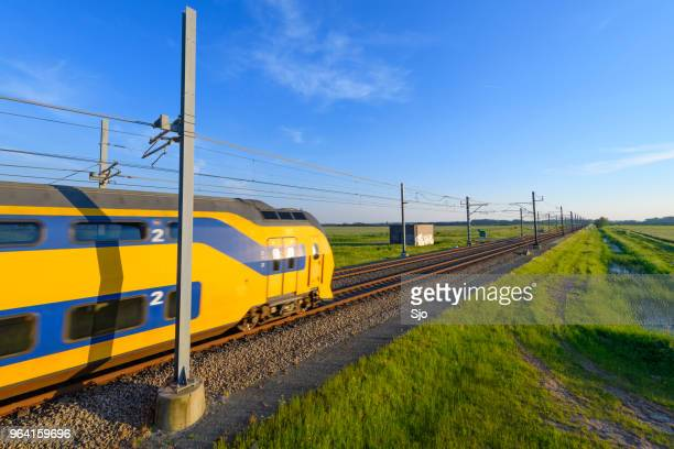 """intercity train of the dutch railways driving in springtime landscape - """"sjoerd van der wal"""" or """"sjo"""" stock pictures, royalty-free photos & images"""