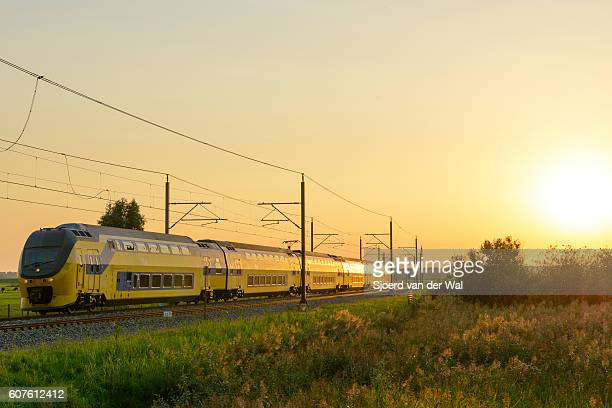 "intercity train of the dutch railways driving past during sunset - ""sjoerd van der wal"" photos et images de collection"