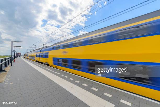 intercity train of the dutch railways, ns, driving past at kampen zuid station - station stock pictures, royalty-free photos & images