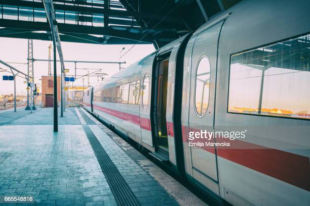 intercity-express (ice) train at platform - railroad station stock pictures, royalty-free photos & images