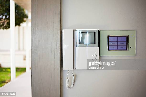 intercom on wall at building entrance - intercom stock pictures, royalty-free photos & images