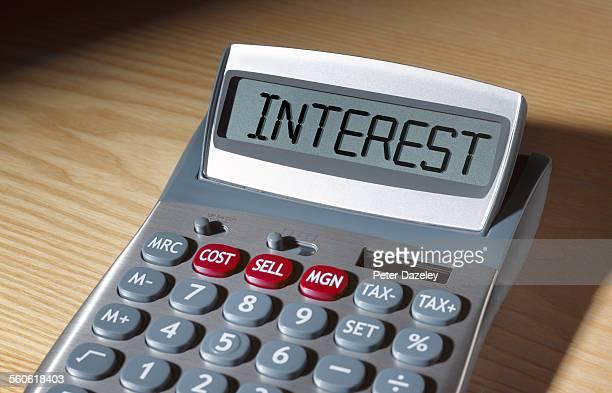 interest written on calculator - zinssatz stock-fotos und bilder