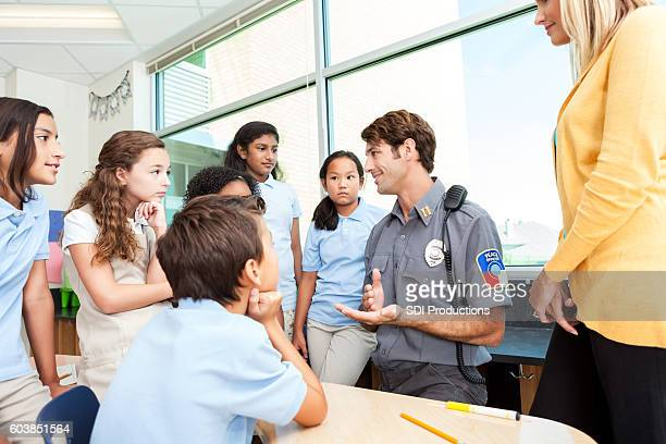 Interested private school students listen to police officer
