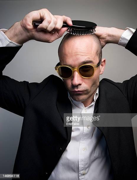 Interesting bald Guy combing itself