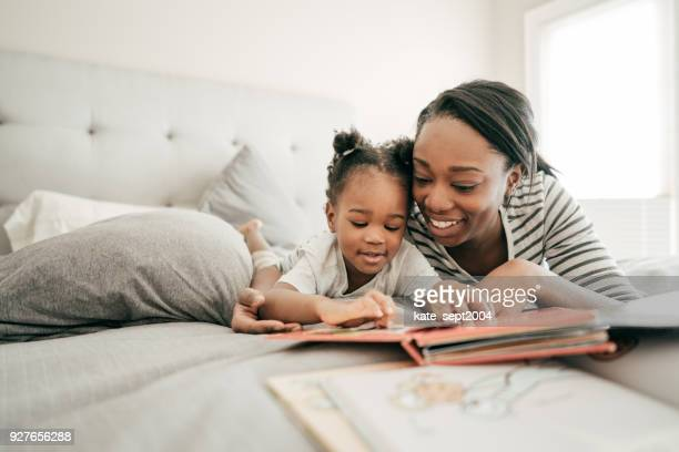 interesting story - mother daughter stock photos and pictures