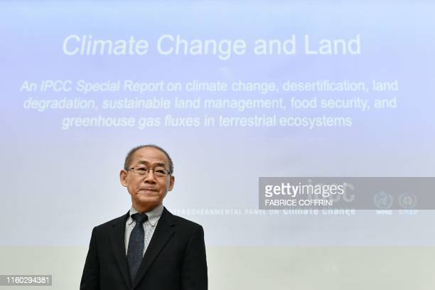 Intergovernmental Panel on Climate Change chairman Hoesung Lee looks arrives to a press conference on a special IPCC report on climate change and...