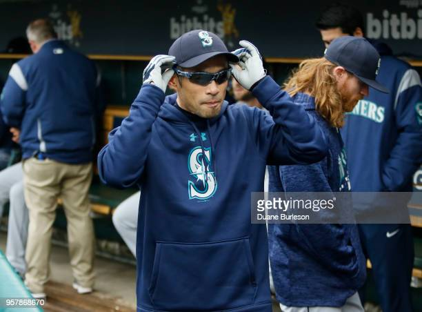 Interim bench coach Ichiro Suzuki of the Seattle Mariners adjusts his glasses while waiting for the start of game one of a doubleheader against the...
