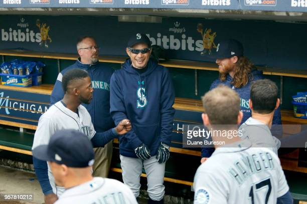 Interim bench coach Ichiro Suzuki of the Seattle Mariners laughs with some players before game one of a doubleheader against the Detroit Tigers at...