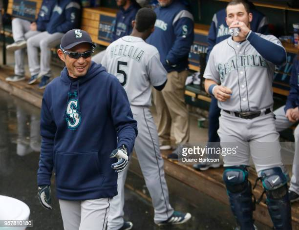Interim bench coach Ichiro Suzuki of the Seattle Mariners smiles as he walks through the dugout before game one of a doubleheader against the Detroit...