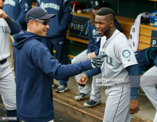 Interim bench coach Ichiro Suzuki of the Seattle Mariners talks with Guillermo Heredia of the Seattle Mariners before game one of a doubleheader...