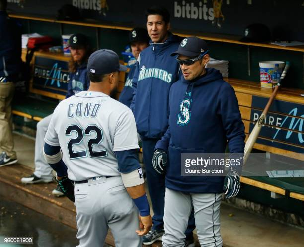 Interim bench coach Ichiro Suzuki of the Seattle Mariners talks with Robinson Cano of the Seattle Mariners beforf game one of a doubleheader against...