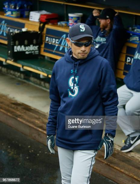 Interim bench coach Ichiro Suzuki of the Seattle Mariners walks through the dugout before game one of a doubleheader against the Detroit Tigers at...