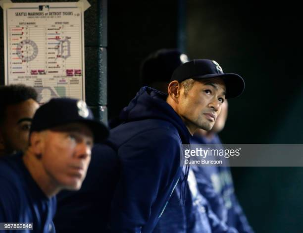 Interim bench coach Ichiro Suzuki of the Seattle Mariners watches a fly ball from the dugout during the ninth inning of game two of a doubleheader...