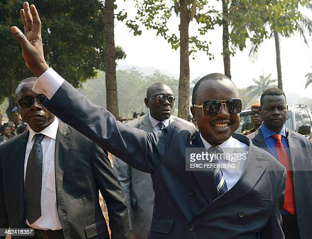 Interim Central African President AlexandreFerdinand Nguendet waves at the Izamo gendarmerie camp in Bangui on January 13 as members of the...