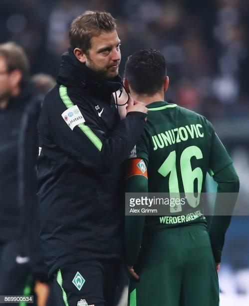 Interim coach Florian Kohfeldt and Zlatko Junuzovic of Bremen react after the Bundesliga match between Eintracht Frankfurt and SV Werder Bremen at...