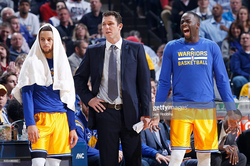 Interim coach Luke Walton looks on alongside Draymond Green #23 and Stephen Curry #30 of the Golden State Warriors in the first half of the game against the Indiana Pacers at Bankers Life Fieldhouse on December 8, 2015 in Indianapolis, Indiana. The Warriors defeated the Pacers 131-123 to move to 23-0 on the season.