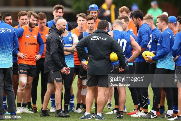 Interim coach of the Kangaroos Rhyce Shaw speaks to his team during a North Melbourne Kangaroos AFL training session at Arden Street Ground on June...