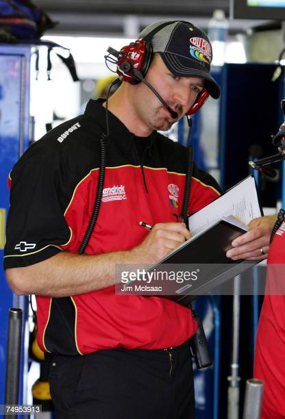Interim crew chief, Jeff Meendering, works on DuPont Chevrolet driven by Jeff Gordon, in the garage during practice for the NASCAR Nextel Cup Series...