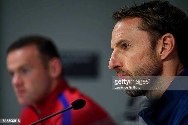 Interim England manager Gareth Southgate speaks next to Wayne Rooney during an England press conference ahead of the FIFA 2018 World Cup Qualifier...