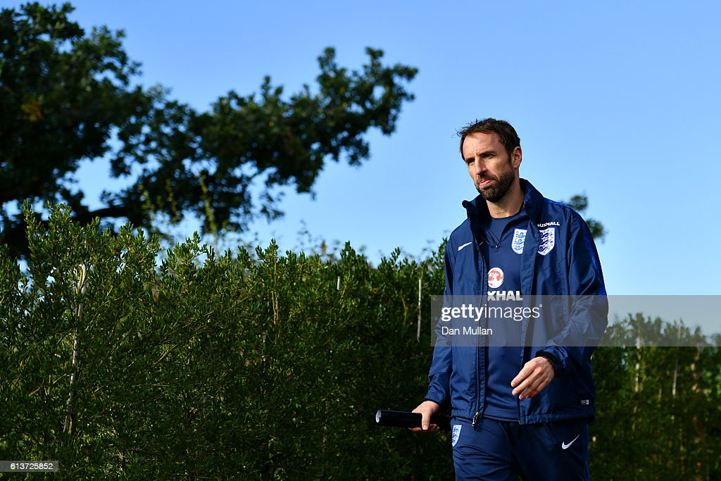 Interim England manager Gareth Southgate walks out with his players for an England training session at the Tottenham Hotspur training ground on October 10, 2016 in Enfield, England.