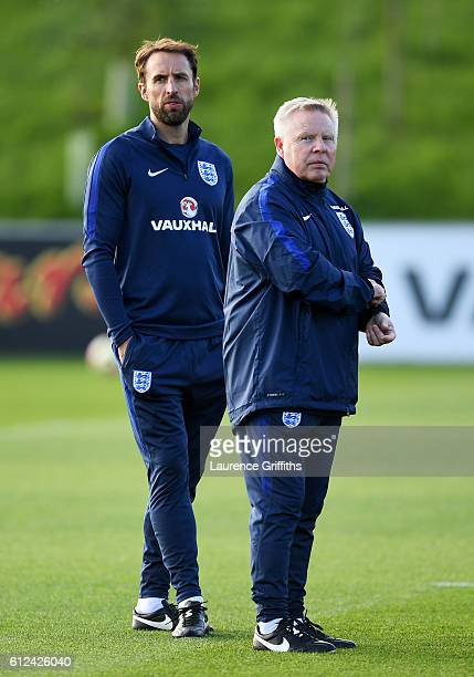 Interim England manager Gareth Southgate watches his players next to his assistant Sammy Lee during an England training session at St George's Park...