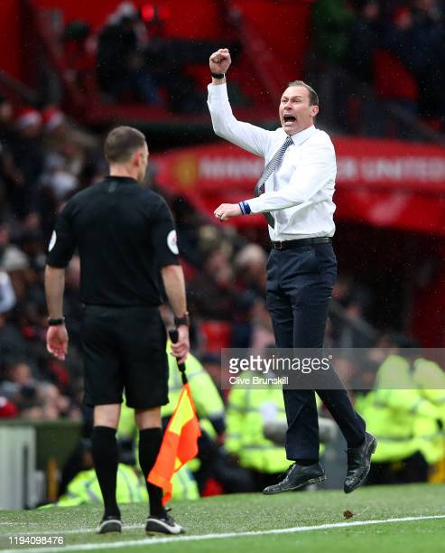 Interim Everton Manager Duncan Ferguson celebrates after his team's first goal during the Premier League match between Manchester United and Everton...
