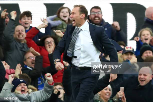 Interim Everton Manager Duncan Ferguson celebrates his team's third goal during the Premier League match between Everton FC and Chelsea FC at...