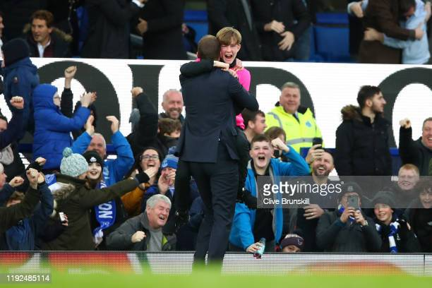 Interim Everton Manager Duncan Ferguson celebrates his team's third goal with a ball boy during the Premier League match between Everton FC and...