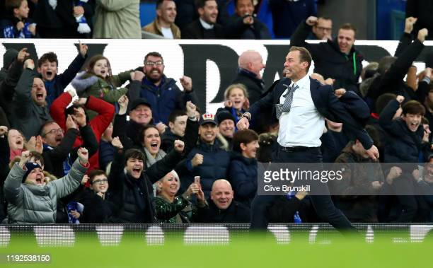 Interim Everton Manager Duncan Ferguson celebrates his team's third goal with the crowd during the Premier League match between Everton FC and...