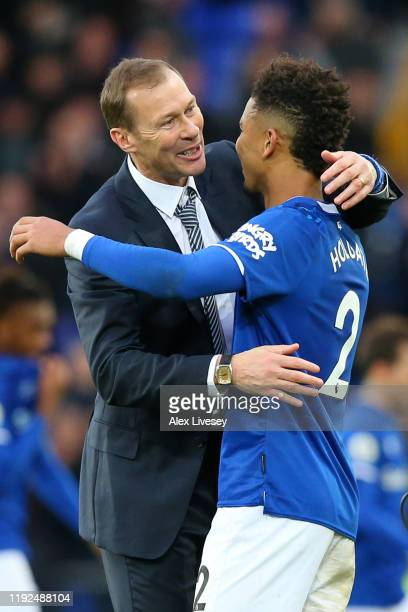 Interim Everton Manager Duncan Ferguson celebrates victory with Mason Holgate of Everton following the Premier League match between Everton FC and...