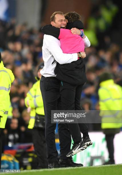 Interim Everton Manager Duncan Ferguson celebrates with a ball boy after his sides second goal during the Carabao Cup Quarter Final match between...
