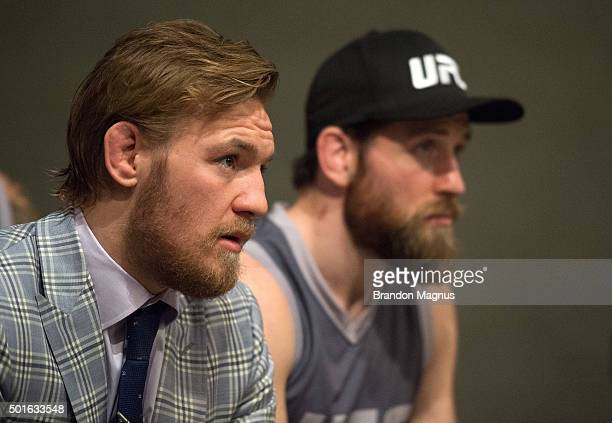 Interim featherweight champion Conor McGregor and assistant coach Tom Egan listen to UFC President Dana White's speech during the filming of The...