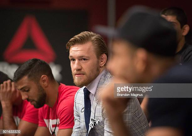 UFC interim featherweight champion Conor McGregor interacts with UFC featherweight Champion Jose Aldo before watching the semifinal fights during the...