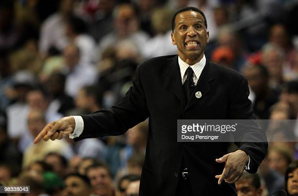 Interim head coach Adrian Dantley of the Denver Nuggets directs his team against the Los Angeles Lakers during NBA action at the Pepsi Center on...