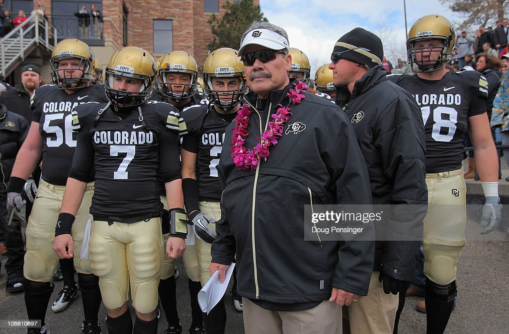 Interim head coach Brian Cabral prepares to lead Cody Hawkins #7 and the Colorado Buffaloes onto the field to face the Iowa State Cyclones at Folsom Field on November 13, 2010 in Boulder, Colorado. Cabral made his debut as interim head coach after head coach Dan Hawkins was fired this week as Colorado defeated Iowa State 34-14.