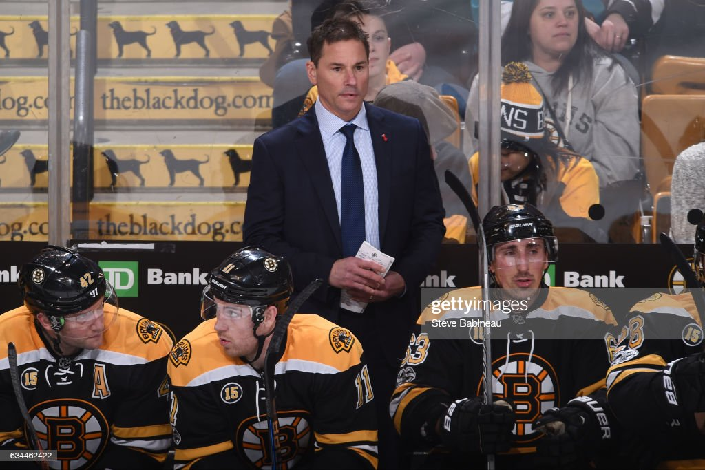Interim Head Coach Bruce Cassidy of the Boston Bruins on the bench during the game against the San Jose Sharks at the TD Garden on February 9, 2017 in Boston, Massachusetts.