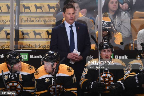 Interim Head Coach Bruce Cassidy of the Boston Bruins on the bench during the game against the San Jose Sharks at the TD Garden on February 9 2017 in...