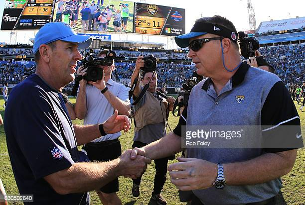 Interim head coach Doug Marrone of the Jacksonville Jaguars shakes hands with head coach Mike Mularkey of the Tennessee Titans after the game at...
