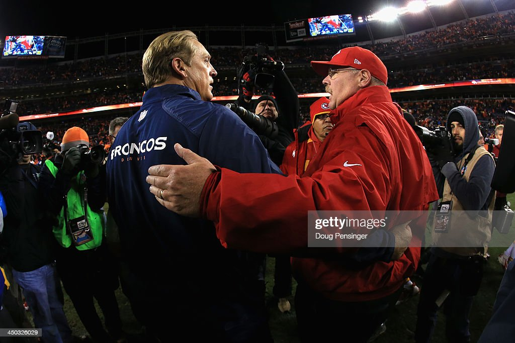 Interim head coach Jack Del Rio of the Denver Broncos and head coach Andy Reid of the Kansas City Chiefs meet after the game at Sports Authority Field at Mile High on November 17, 2013 in Denver, Colorado. The Denver Broncos defeated the Kansas City Chiefs 27-17.