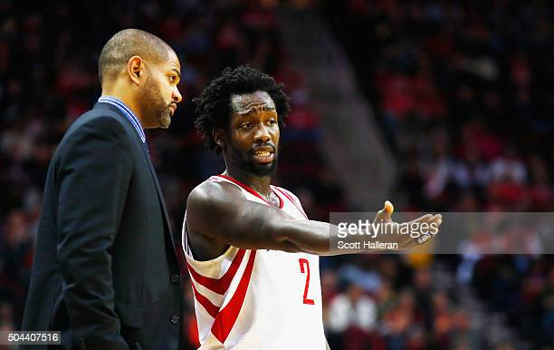 Interim head coach JB Bickerstaff and Patrick Beverley of the Houston Rockets wait near the bench during their game against the Indiana Pacers at the...
