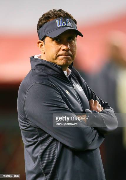 UCLA interim head coach Jeff Fisch stands on the sideline during the NCAA football Cactus Bowl game between the Kansas State Wildcats and the UCLA...
